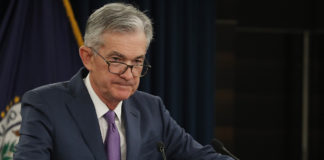 Divided Fed cuts interest rates